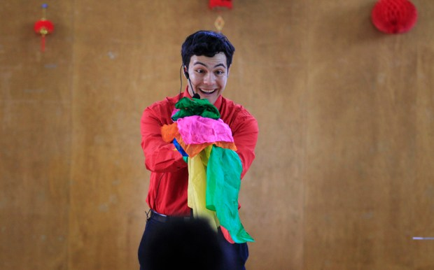 Nathaniel Segal, aka Magical Nathaniel, performs a magic trick at the Alameda County and BART 2016 Lunar New Year Celebration at the Lincoln Square Recreation Center in Oakland, Calif., on Tuesday, Feb. 9, 2016. Children from schools throughout the Bay Area participated in the celebration. (Laura A. Oda/Bay Area News Group)