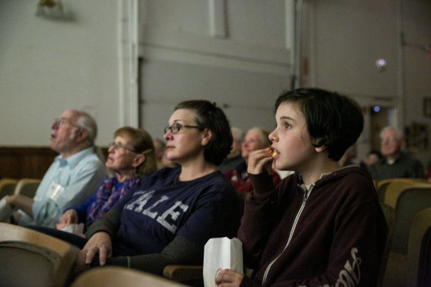 Kira MacMiller, 11, and her mother Kimberlee MacMiller, of Alameda, watch asilent film presentation as part of a members event celebrating the new expansion of the Niles Essanay Silent Film Museum on Feb. 19, 2017. Photo by Joseph Geha.