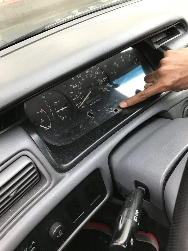In an undated photo shared by lawyer John Burris' office, Patrick Reddic, 30, points to bullet holes left in the dash of his 2001 Toyota Camry after Jesse Ross Enjaian shot at it while Reddic was sleeping in it Feb. 14, 2017. Enjaian died Feb. 17 hours after police shot him during a standoff in the 9500 block of Las Vegas Avenue.