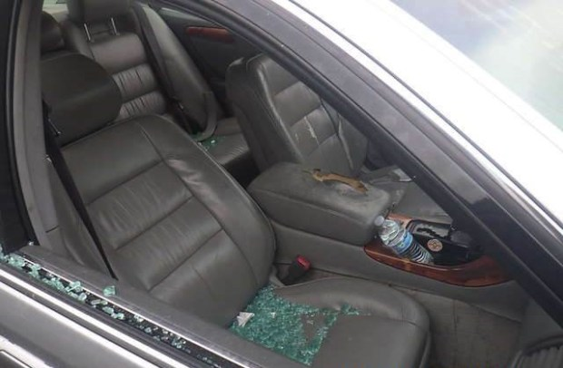 In an undated photo shared by lawyer John Burris' office, glass litters the passenger seat of Patrick Reddic's 2001 Toyota Camry after Jesse Ross Enjaian shot at it while Reddic was sleeping inside it Feb. 14, 2017. Enjaian died Feb. 17 hours after police shot him during a standoff in the 9500 block of Las Vegas Avenue.