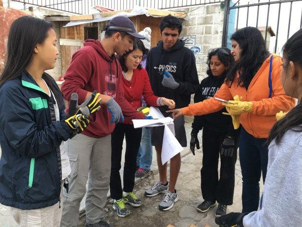 Volunteers start look over the blueprints of a house in Tijuana, Mexico. The home construction was a project of students volunteers who traveled to Mexico during Winter break 2016 through a collaboration with the nonprofit DOXA.