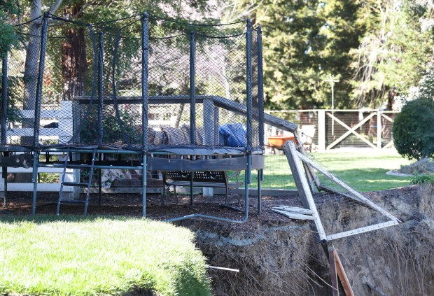 A trampoline hangs off the edege of the backyard of a home along Foothill Road on Wednesday, March8, 2017, in Pleasanton, Calif. About 30 feet of the backyard has been lost to erosion from the Arroyo de la Laguna stream. (Aric Crabb/Bay Area News Group)