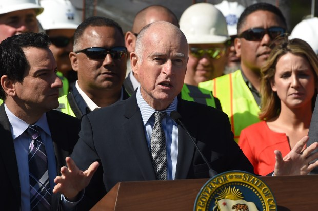 Gov. Jerry Brown talks about a $5 billion proposal to repair California's crumbling roads and bridges by raising fuel taxes, hiking vehicle registration fees and charging electric car owners a yearly fee during a press conference in Concord, Calif., on Thursday, March 30, 2017. Brown stressed the need for roads and bridges to be fixed now. (Susan Tripp Pollard/Bay Area News Group)