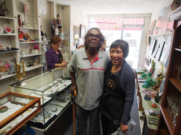 "CREDIT: CHRIS TREADWAYJuanita Tims of El Cerrito, standing with store volunteer Nancy Okasaki, is a longtime customer at the Turnabout Shop. ""Every day its open, I'm in here,"" she says."