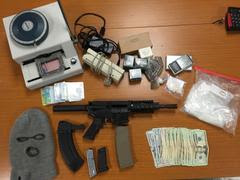 Items seized by police during Sunday's arrests included 1,000 pills of five different narcotics, a loaded AR-15 assault pistol, dozens of rounds of ammunition and a card reader/writer and card stock used in identity theft operations. (Berkeley Police Department)