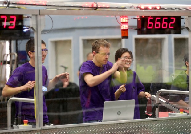 Members of team E.W.A. (Engineers With Attitude), from left, Max Morehead, 17, Marcus Sander, 18, and Hayoun Lim, 17, from College Park High School celebrate while competing in a match at the FIRST (For Inspiration and Recognition of Science and Technology) robotics competition held at St. Ignatius College Preparatory in San Francisco, Calif., on Saturday, March 18, 2017. Some 40 high school teams competed in the robotics competition that builds science, engineering, and technology skills. (Anda Chu/Bay Area News Group)