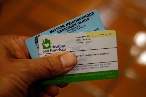 Maria Conseulo, a member of Healthy San Francisco, visits Zuckerberg San Francisco General Hospital with her identification cards, Wednesday, March 29, 2017, in San Francisco, Calif. (Karl Mondon/Bay Area News Group)
