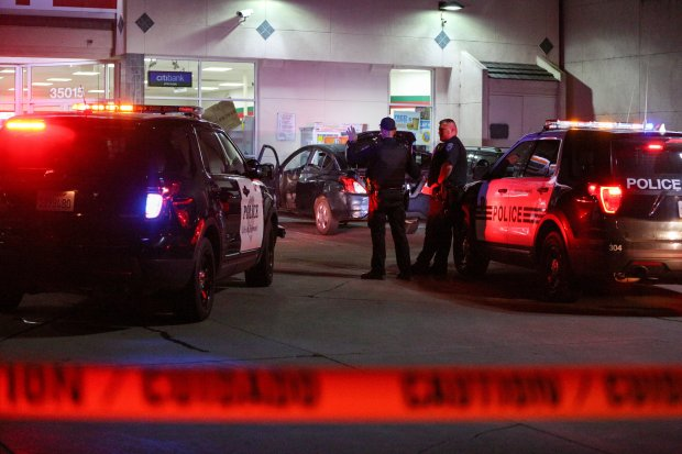 A man who fled from the car, center, in the parking lot of a 7-Eleven wasshot at by Fremont police officers late Sunday night after police said he fired a gun at them from on top of a box truck. Authrities say the man killed himself with a gunshot to the head. (Joseph Geha/The Argus)