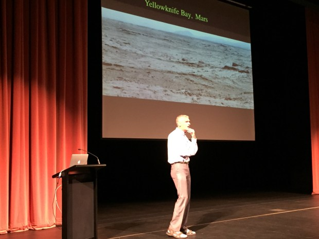 NASA scientist Chris McKay displays a photo of Yellowknife Bay on Mars during a presentation at Livermore's first innovation fair on Saturday, April 9. McKay travels to Earth's most inhospitable environments to help facilitate a possible manned mission to Mars.