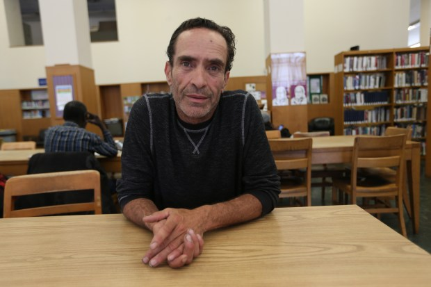 Mark Holys is photographed at the Oakland Public Library in downtown, Oakland, Calif., on Wednesday, May 10, 2017. Holys is homeless and comes into the library to use the internet and charge his laptop and phone. He used to be a sommelier and server in various Bay Area high-end restaurants. (Jane Tyska/Bay Area News Group)