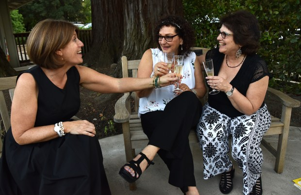 Long time friends Hilary Friedman, left, Alison Trules, center, and Susan Light, right, all from Walnut Creek, toast each other, May 20, 2017, at a reception at Founder's Grove in Lafayette, after getting Bar mitzvah together earlier in the day at the Congregation B'nai Tikvah. The three women in their 60's went to Berkeley together for graduate school decades ago and have been close friends ever since. (Photo By Dan Rosenstrauch)
