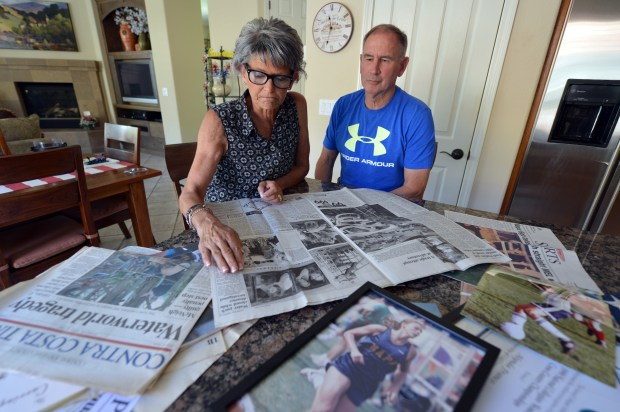 Barbara and Vic Franco look over some mementos from their daughter's high school years at their home in Napa, Calif. on Friday, June 2, 2017. The Franco's daughter, Alynda, was a senior at Napa High School and was badly injured in the accident at Waterworld 20 years ago. (Kristopher Skinner/Bay Area News Group)
