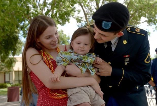 After going through a graduation ceremony in the school quad, Harland Fletcher, a private first class reservist in the U.S. Army, visits with his wife Tina Fletcher and their son Gabriel, at Liberty High School in Brentwood, Calif., on Monday, June 12, 2017. Fletcher decided to skipped the Friday ceremony with the rest of his class rather than cover his Army uniform with a cap and gown. (Susan Tripp Pollard/Bay Area News Group)