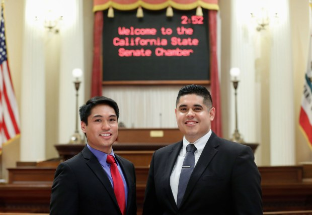 Pittsburg natives Dana Cruz, left, and Miguel Mauricio at work in the Capitol building in Sacramento