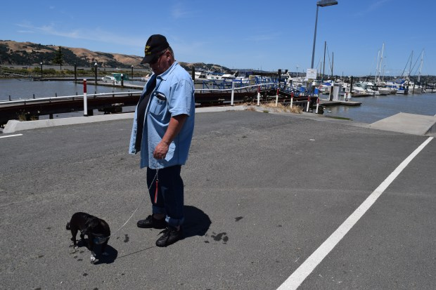 Rodney Schuman of Clyde was at the Martinez Marina Thursday, June 1 to help get his dog Brentwood accustomed to being in the water.