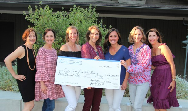 The Lafayette Juniors present a donation to 2016-2017 beneficiaries of the spring Kitchen Tour event, to Contra Costa Interfaith Housing. Pictured from left are Cathy Kauder, Mindy Harmeyer, Erica Mason, Deanne Pearn of Contra Costa Interfaith Housing, Tina Frechman, Rachel Blatt and Jeannine Palmer.