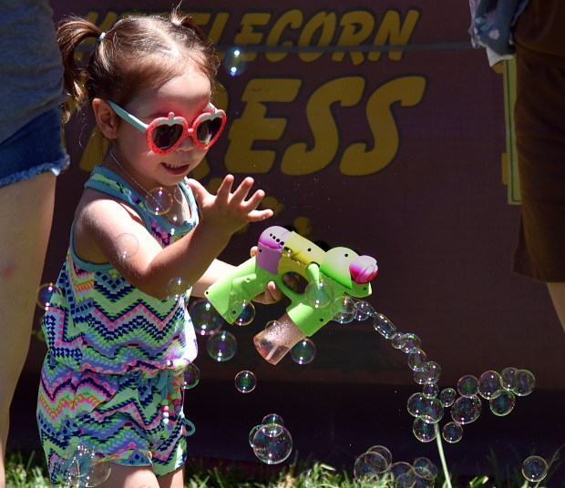 Olivia Kneen, 2, of Martinez, finds fun in blowing and catching bubbles during The11th annual King of the County BBQ and Music Fest, June 17, 2017, at the Martinez Waterfront Park. (Photo by Dan Rosenstrauch)