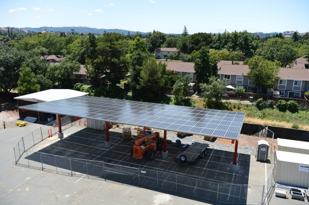 The installation of solar panels in the parking lot of the Contra Costa Fire District Training Center is well underway in Concord, Calif. on Thursday, June 1, 2017. (Kristopher Skinner/Bay Area News Group)