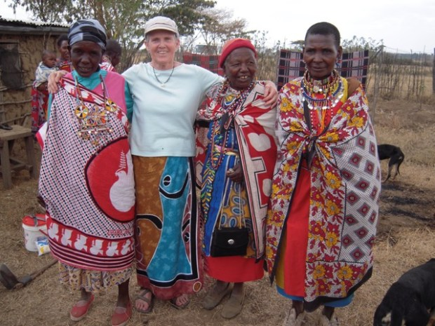 Sally Scholl stands with members of the Rise and Shine women's group in Moi Ndabi, Kenya where Scholl offered a lesson on clean water. (Photo courtesy of Sally Scholl)