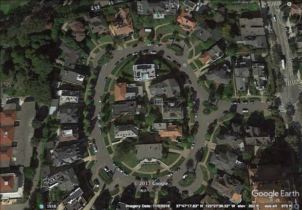 A Google Earth image depicts Presidio Terrace in San Francisco. Residents who live in the multi-miliion dollar mansions on the private, oval-shaped drive have learned a San Jose real estate developer and his wife have purchased their street in an auction for a little over $90,000 to settle a delinquent property tax bill. The buyers, Tina Lam and Michael Cheng, are now plotting how they can monetize their purchase, including charging residents to park their cars on the street. (Courtesy Google Earth)