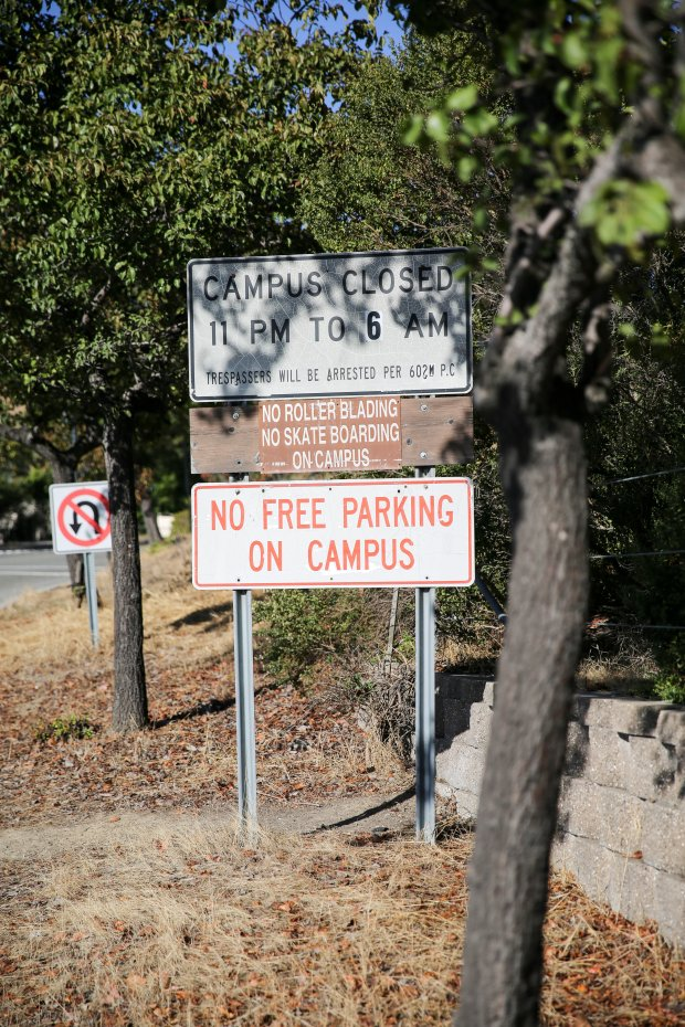"A sign along Pine Street leading to Ohlone College's parking lots reading ""No free parking on campus"" is seen on Sept. 19, 2017. Parking is free on Sundays, however, until a planned change takes effect on Nov. 1. (Joseph Geha/The Argus)"