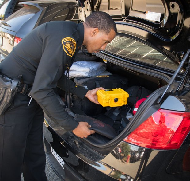 Contra Costa Sheriff's Lt. David Hall places a kit containing the drug Naloxone into the trunk of a patrol car. patrol vehicle. Sheriff's deputies and investigators have been trained to administer Naloxone, which reverses the effects of an opioid overdose.