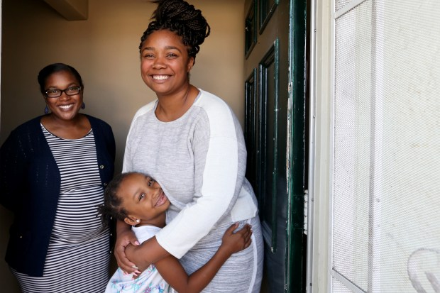 Community housing coordinator Kamela Stewart, left, is photographed with her client Dajonna Benjamin, 22, and her five-year-old daughter Leniyah Dugan, at transitional housing for foster youth in Oakland, Calif., on Thursday, Oct. 20, 2017. The program is part of Beyond Emancipation which provides several programs to help former foster and probation youth to overcome challenges and make successful transitions to adulthood and independent living. (Ray Chavez/Bay Area News Group)