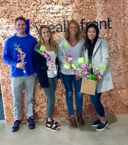 """Wealthfront in Redwood City enjoyed sharing bouquets from """"Petal It Forward"""" on Oct. 11. Shown, from left, are: Kevin Teaque, Courtney Burrell, Kara Brenholt and Jacqueline Ow. (Courtesy of Valerie Lee Ow)"""