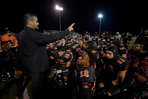 Pittsburg head coach Victor Galli addresses his players after defeating San Ramon Valley during their NCS Open Division semifinal game in Pittsburg, Calif. on Saturday, Nov. 18, 2017. Pittsburg defeated San Ramon Valley 16-7. (Jose Carlos Fajardo/Bay Area News Group)
