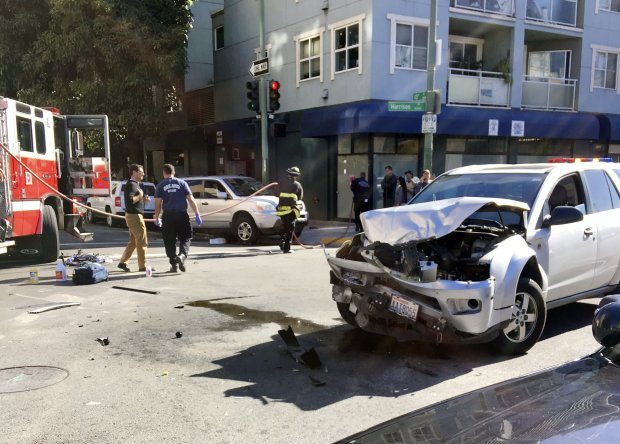 Two SUV vehicles collided ago the intersection of 13th and Harrison Streetsin Oakland, Calif., causing one of the vehicles to hit an 89-year-old pedestrian on the sidewalk on Tuesday, Nov. 7, 2017. (Harry Harris/ Bay Area News Group)