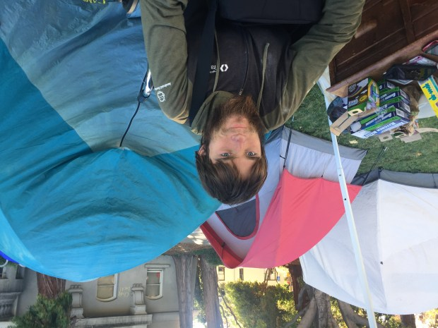 Jake Atkinson sits at a camp in front of Berkeley's Old City Hall on Nov. 6, 2017. (Tom Lochner)