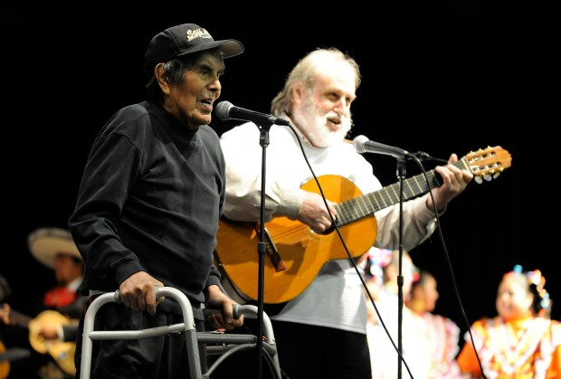 "Guillermo ""Bill"" Muniz, of Pittsburg, sings ""De Colores"" with longtime friend Daniel Zwickel, right, during the Cesar Chavez State Holiday event held at the Marion Beede Auditorium in Antioch, Calif., on Sunday, April 1, 2012. (Jose Carlos Fajardo/Bay Area News Group/Archive)"