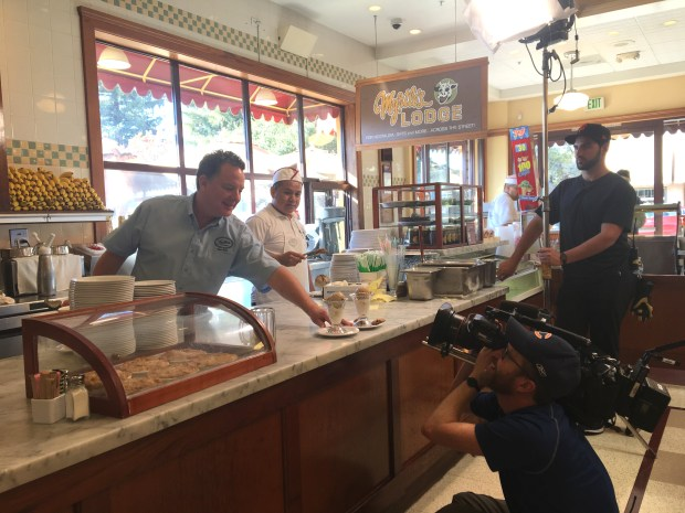 "Fenton's Creamery owner Gregory Scott Whidden serves a couple of Fenton's iconic sundaes for the Travel Channel show ""Food Paradise."" (Sarah Tan/For Bay Area News Group)"