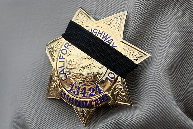 The badge of California Highway Patrol Golden Gate Division Assistant Chief Ernie Sanchez is photographed on Dec. 25, 2017, in Hayward, Calif. (Aric Crabb/Bay Area News Group)