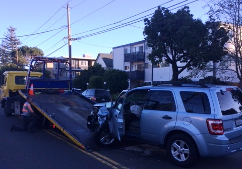 Nate Jackson/for Bay Area News GroupA car is towed Sunday, Dec. 3, 2017, after a three-vehicle collision on Lincoln Avenue between Walnut and Willow streets. Officers at the scene said crash victims went to the hospital with minor injuries, the accident is being investigated as a hit-and-run, no arrests have been made and the block was closed to traffic for about a half-hour.