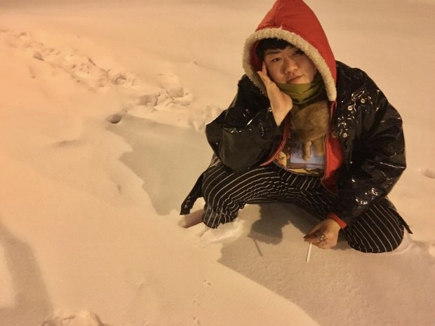 "Ara Jo poses in the snow on January 25, 2016 in Washington D.C. She is ""inher favorite Chef's pants, vintage mink stole, and what we affectionately called her 'South Park' hoodie,"" according to Jo's cousin, Grace Kim. (Courtesy Grace Kim)"
