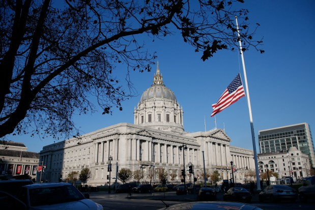 Flags fly at half-mast over City Hall in San Francisco, Calif., after Mayor Ed Lee died Tuesday, Dec. 12, 2017. (Karl Mondon/Bay Area News Group)