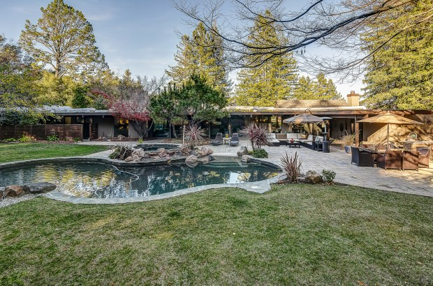 This west-side Danville home's backyard is a sprawling oasis with paved patios, Pebble Tec swimming pool and spa, Lynx kitchen and koi pond.