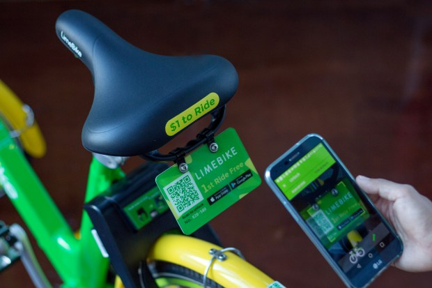 Using a smartphone, riders scan the QR code or type in the plate number to unlock a LimeBike.