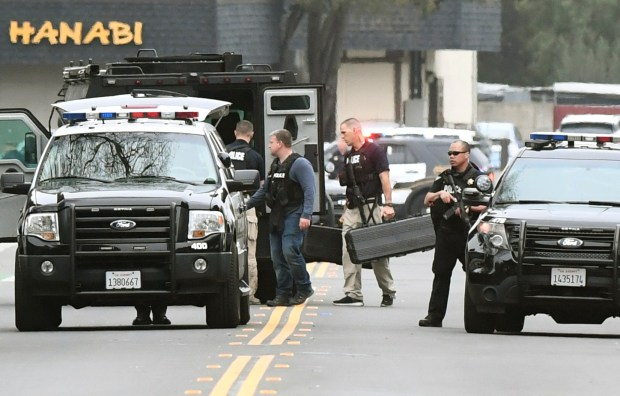 Pleasanton police cordon off Stanley Boulevard between Main Street and First Street after a man barricaded himself inside a house in Pleasanton, Calif., on Tuesday, Jan. 16, 2018. A bystander said the man was fleeing from the police in a Nor Cal Bail Bonds truck before stoping and running in to the house. (Doug Duran/Bay Area News Group)
