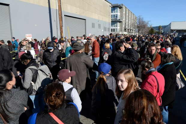 Thousands of customers line up outside waiting to enter a preview sale for the 59th annual White Elephant Sale in Oakland, Calif., on Sunday, Jan. 28, 2018. Some customers lined up at 3 a.m. to be first in line. Funds raised by the event support the Oakland Museum of California. The event is organized and presented by Oakland Museum's Women's Board and has raised more than $2 million for each of the past three years. The White Elephant Sale will be held on March 3rd and 4th. (Jose Carlos Fajardo/Bay Area News Group)