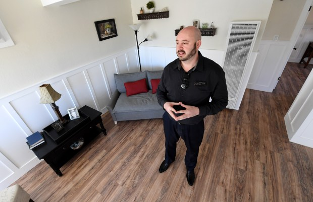 Real estate agent David Greene, of Discovery Bay, is photographed as he talks about a house that he and a business partner purchased and remodeled that is now for sale in Martinez, Calif., on Thursday, Feb. 15, 2018. Greene, who is also a BART police officer, buys run-down houses, fixes them up and rents them out or sells them. He has written a book about how he does it and has been featured on an episode of HGTV's House Hunters. (Doug Duran/Bay Area News Group)