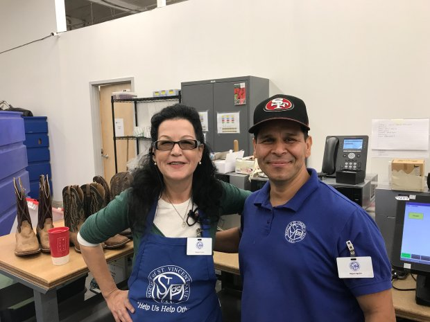 Miguel Augliar and Renee Sparks, St. Vincent de Paul Brentwood store clerks , are ready for customers at the new store. Courtesy Keiyanna Coldcleugh/St. Vincent de Paul