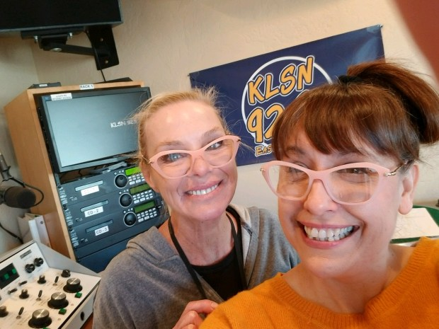 (left to right) Rose Greyshock and Charleen Earley pose for a selfie during their morning show at KLSN 92.9 (Courtesy Charleen Earley)