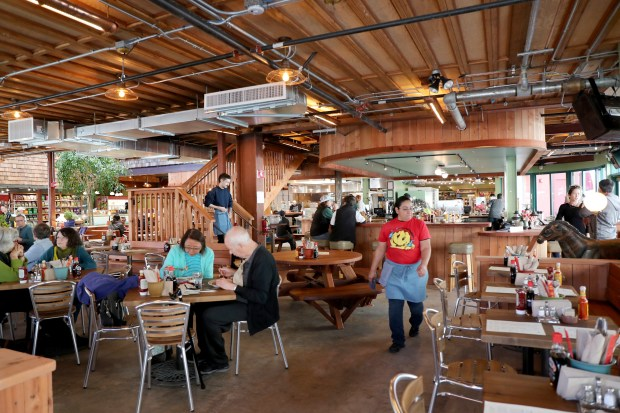 Patrons have lunch at the new Chow Oakland Cafe, Bakery & Market. (Ray Chavez/Bay Area News Group)