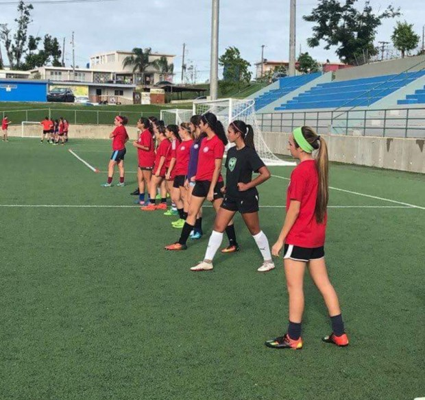Kiara Rodriguez (in black) prepares for practice with the U17 women's soccer team in Puerto Rico.