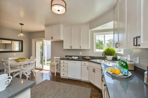 The sunny, updated eat-in kitchen leads out to the spacious backyard.