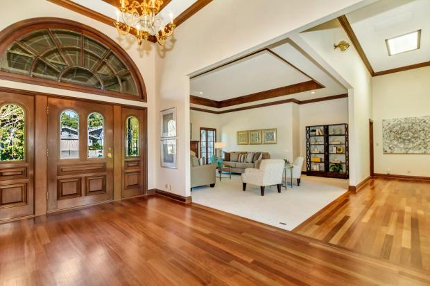The Bryan Ranch home in Alamo starts off with double front doors with leaded glass accents that welcome you into the grand foyer.