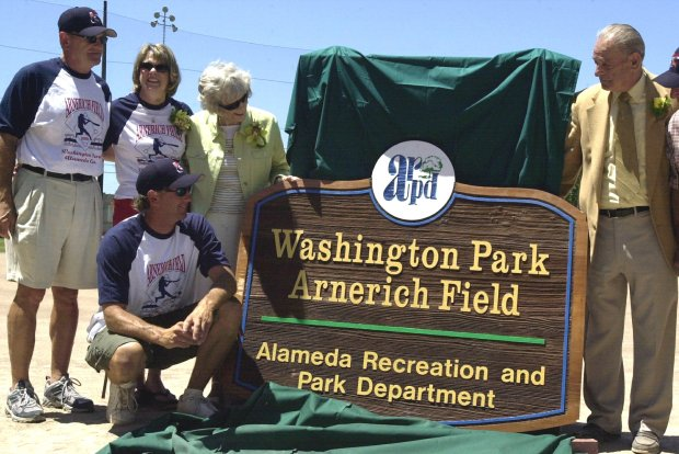 Lil Arnerich, right, and his wife Norma and three of their four children, Mel, Laurie and Ken, left, stand next to the new Washington Park Arnerich Field sign named in honor of Arnerich's family on June 27, 2004. (Velina Nurse/Staff archives)