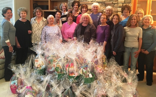 courtesy of Carol BonfiglioMembers of the group Neighbors and Newcomers recently assembled 112 Easter baskets filled with small toys and treats from the St. Vincent de Paul Food Pantry for families in need. Appearing in the photo are Kandace Frediani, from front left, Laurel Smith, Joan Mangiaracina, Ann Smith, Marge Gordon, Laurie Colton, Lucy Blenio, Marian Kass, Sue Fordon, Gloria Cabral, Linda Hughes and Sheila Mohrman; from back left, Vera Braswell, Sheila Shain, Francine Ruotolo, Dora Melendrez, Mary Ditkof and Linda Theuriet.